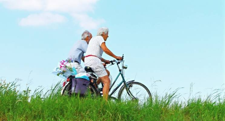 Senior Exercise Bike Couple